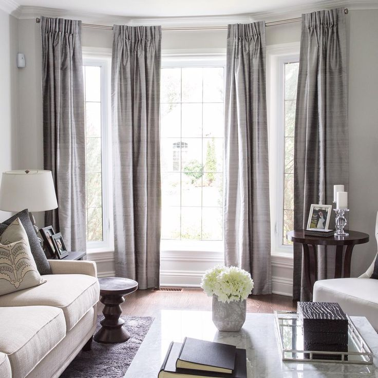 Amazing u201cLovely bay window treatment. Off center window can still work in a bay window curtains for living room
