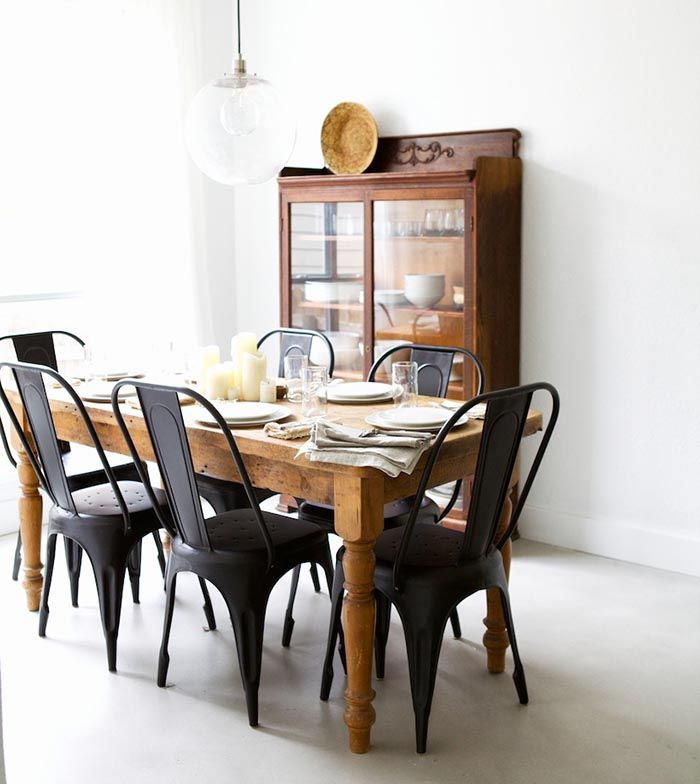 Awesome Matte Black Chairs With A Rustic, Wooden Table From Pineapple Life  (via Black
