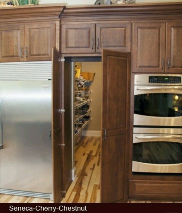 Beautiful door leading to pantry in middle of kitchen cabinets | Doors leading pantry cabinets with doors