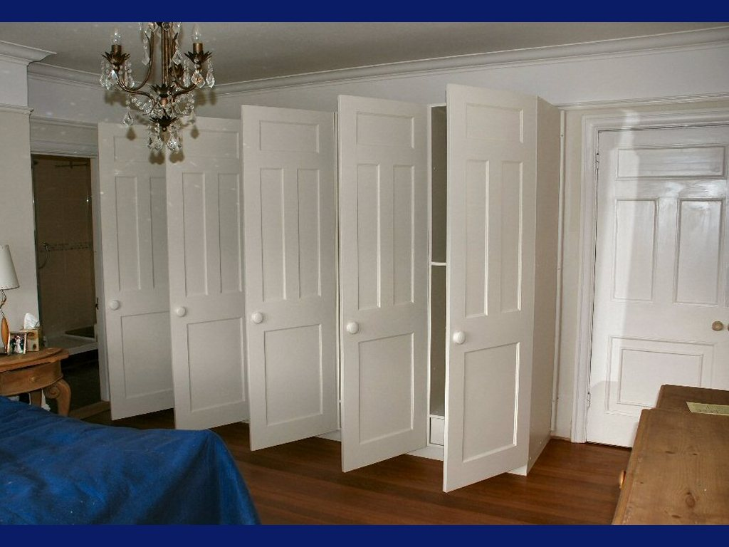 organizing all sorts of apparels in one place in an armoire wardrobe. Black Bedroom Furniture Sets. Home Design Ideas