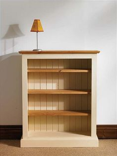 Beautiful Paint and stain wooden bookshelf, light color for a small condo, but still small wooden bookshelf