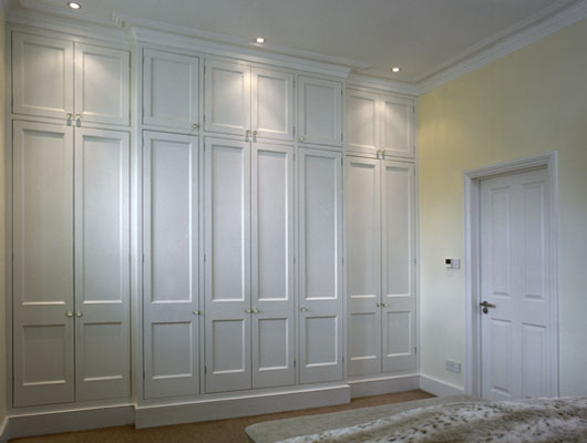 Compact built-in wardrobe - prefer to walk-in closet. Even Ikea wardrobes would bespoke fitted bedroom furniture