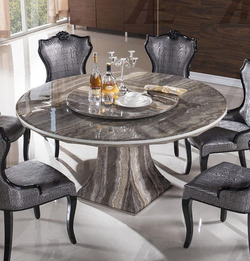 Marble dining furniture gives exotic look to your home for Round stone top dining table