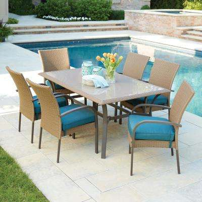 Chic Corranade 7-Piece Wicker Outdoor Dining Set with Charleston Cushions outdoor dining furniture sets