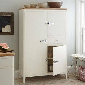 Chic Inspired by 1960s country lodge living, the Cabin Kitchen Armoire white armoire with drawers