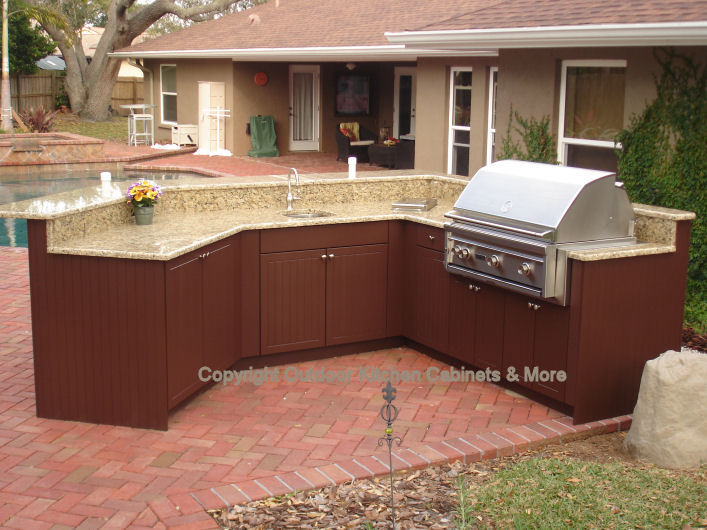 Chic Outdoor Kitchen Exposed To The Elements outdoor kitchen cabinets