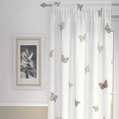 Chic The Butterfly Natural Net Curtain Panel has a white background with a white butterfly curtains