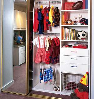 Chic White laminate kids closet with shelves, drawers and hanging space. bedroom storage furniture