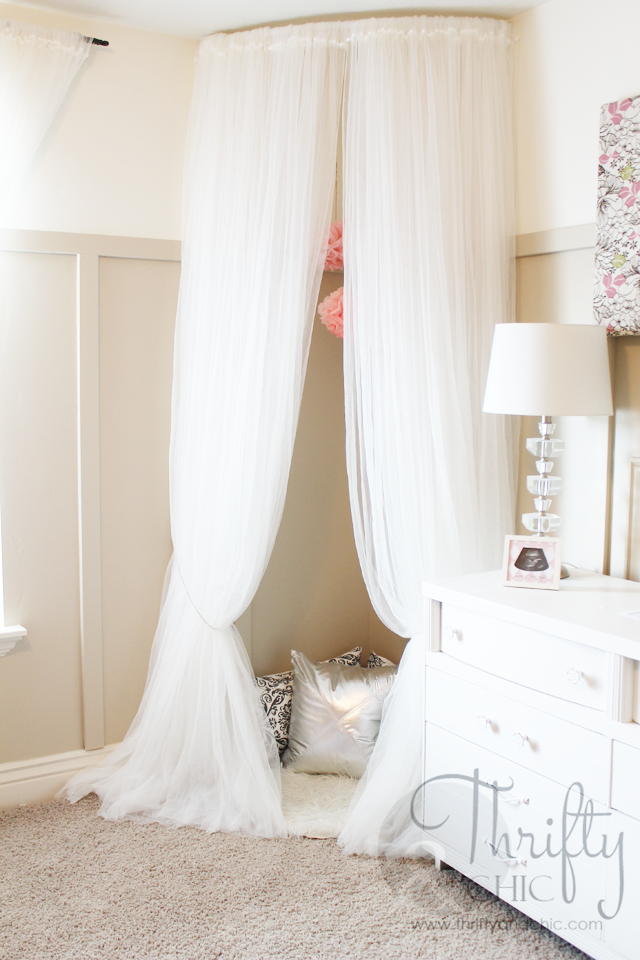 Compact Whimsical Canopy Tent or Reading Nook made from curved curtain rod and $4 curved curtain rod for corner