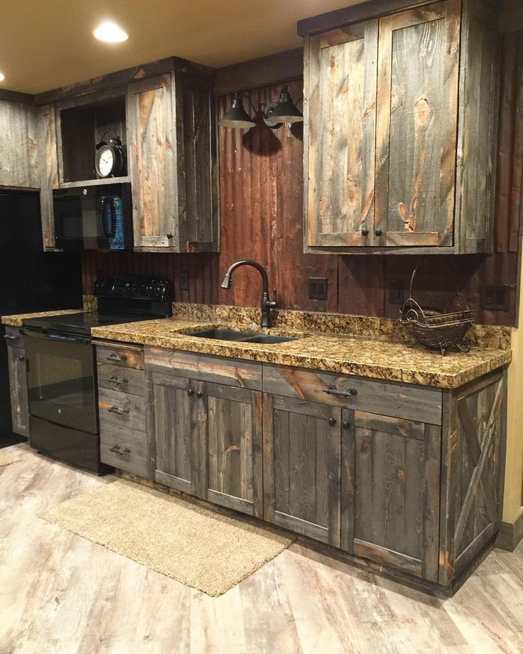 Contemporary A little barnwood kitchen cabinets and corrugated steel backsplash. Love  how rustic wood kitchen cabinets