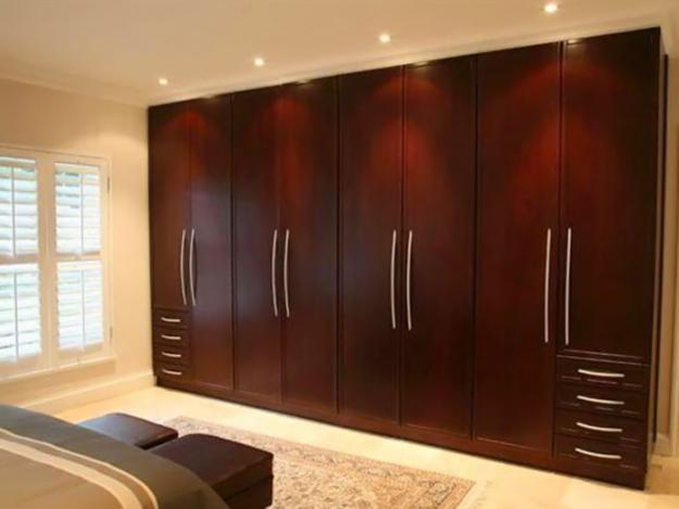 Contemporary Simple traditional wardrobe brown wooden design ideas woodwork designs for bedroom cupboards