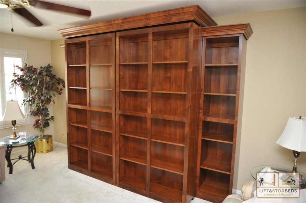 Cozy Bookcases hide a Murphy Bed. Bookcases swing open to reveal bed. Side bookcase wall bed