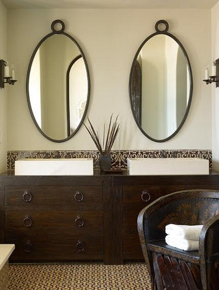 Cozy Green u0026 brown Mediterranean bathroom design with soft green walls, iron oval oval bathroom vanity mirrors