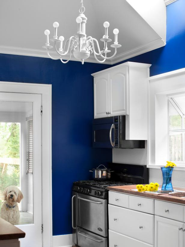 Cute White Kitchen With Bright Blue Walls paint color ideas for kitchen walls