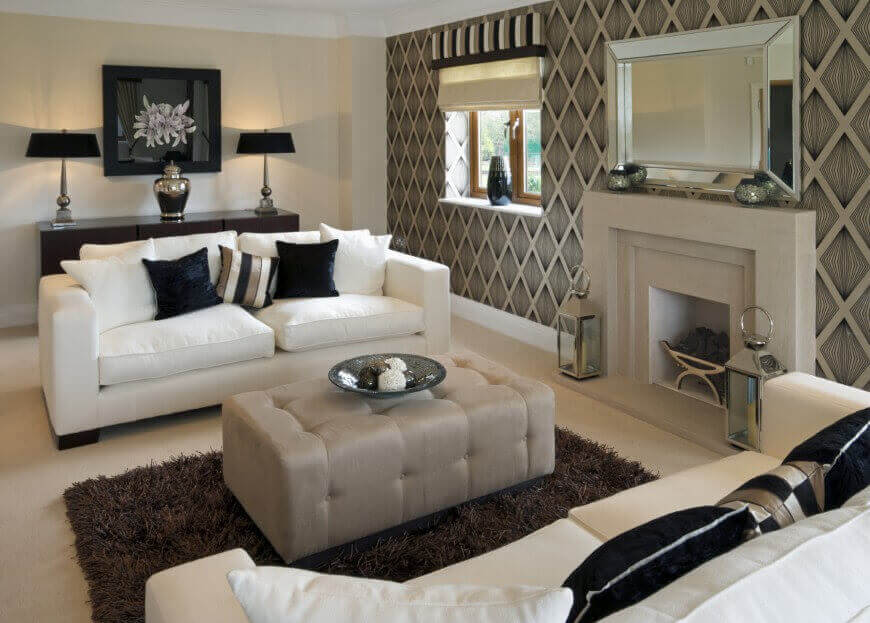 Cozy Modern look living room features white sofas with dark decorative pillows  facing elegant modern living rooms