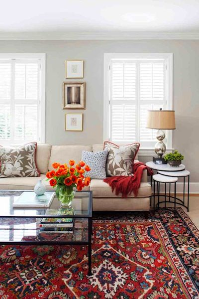 Elegant Transitional living room with oriental rug, custom textiles and nesting  tables. persian rug living room