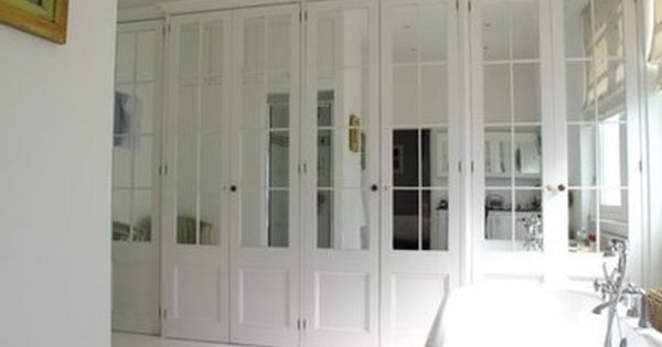 Master Droooooling over these closet doors! Wall-to-Wall mirrored French doors  with white mirrored wardrobe doors