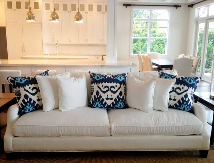 New White sofa with white and blue throw pillows. white sofa pillows