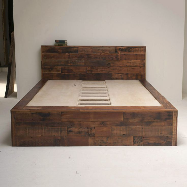 Photos of Amazing bed made of salvaged wood. dark wood bed frame