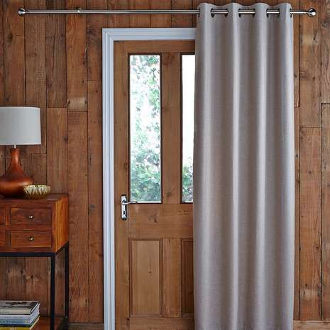 Photos of Featuring an eyelet header, this natural-coloured door curtain is fully  thermal lined thermal door curtain with eyelet heading