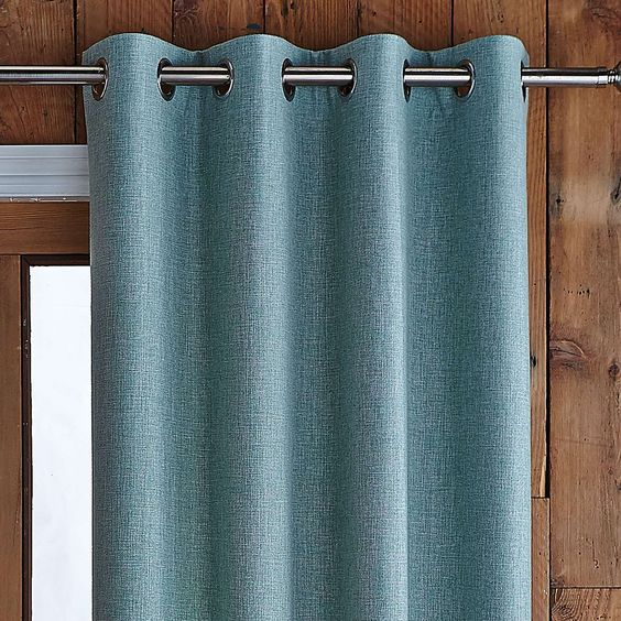 Popular Fully lined to reduce unwanted external draughts, this duck-egg blue thermal  door thermal door curtain with eyelet heading