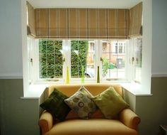 Stunning Square Bay Windows Dressed with Roman Blinds... a cold little corner became square bay window curtains