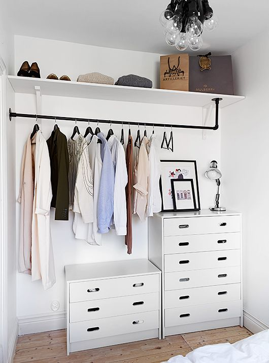 Trending 9 Ways to Store Clothes Without a Closet open wardrobe closet