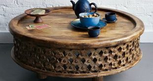 Images of I want this carved Indian Mango Wood Coffee Table from westelm.com but unique round coffee tables