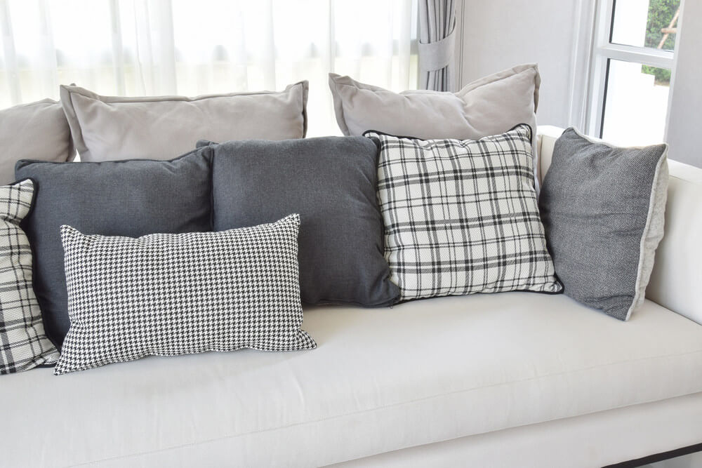 Unique White sofa with charcoal grey and white throw pillows in a variety white sofa pillows