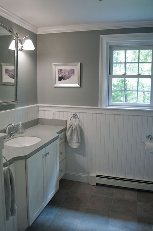 Unique New England bathroom design. Custom by PNB. Porcelain stone look tile, white white beadboard bathroom