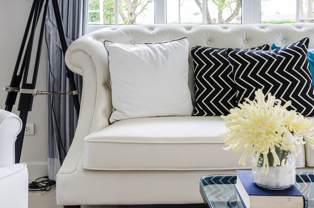 Chic White Sofa With A Pillow And Black Crooked Pillows