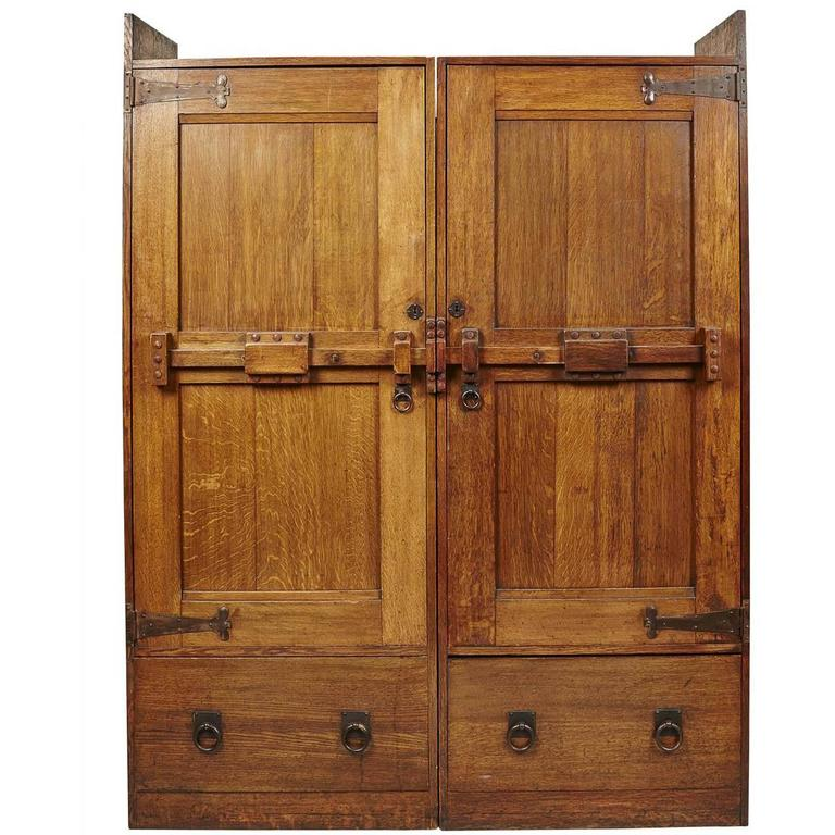 a large arts u0026 crafts oak wardrobe with stylised iron hinges IOWNSAZ