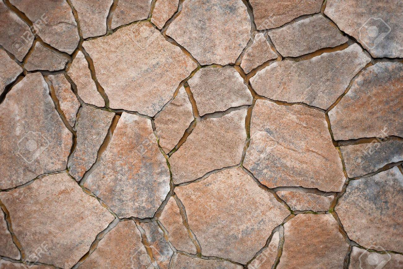 background from paving stones, irregular natural stones stock photo - CULYICD