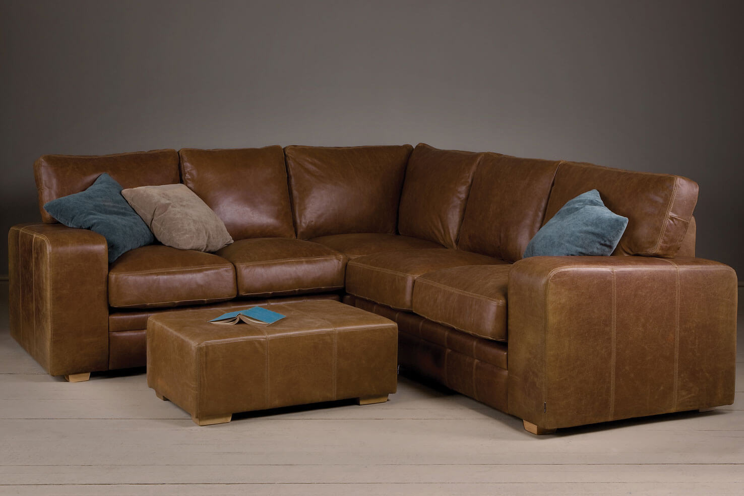 broad arm leather corner sofa with a footstool TGZXHQU