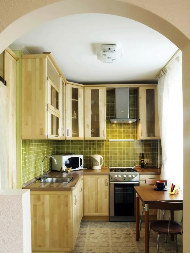 kitchen idea for small space small kitchen with green tile backsplash FBRDTXC