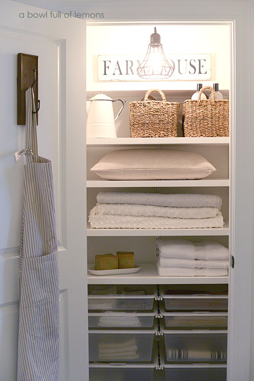 linen closets i love the sign and light and hook on the door UYFDMJO