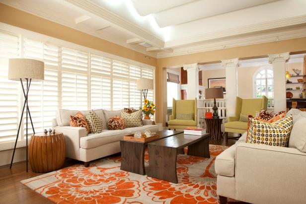 orange rugs for living room living room with orange-and-cream rug, neutral sofas and green chairs ERQGSHC
