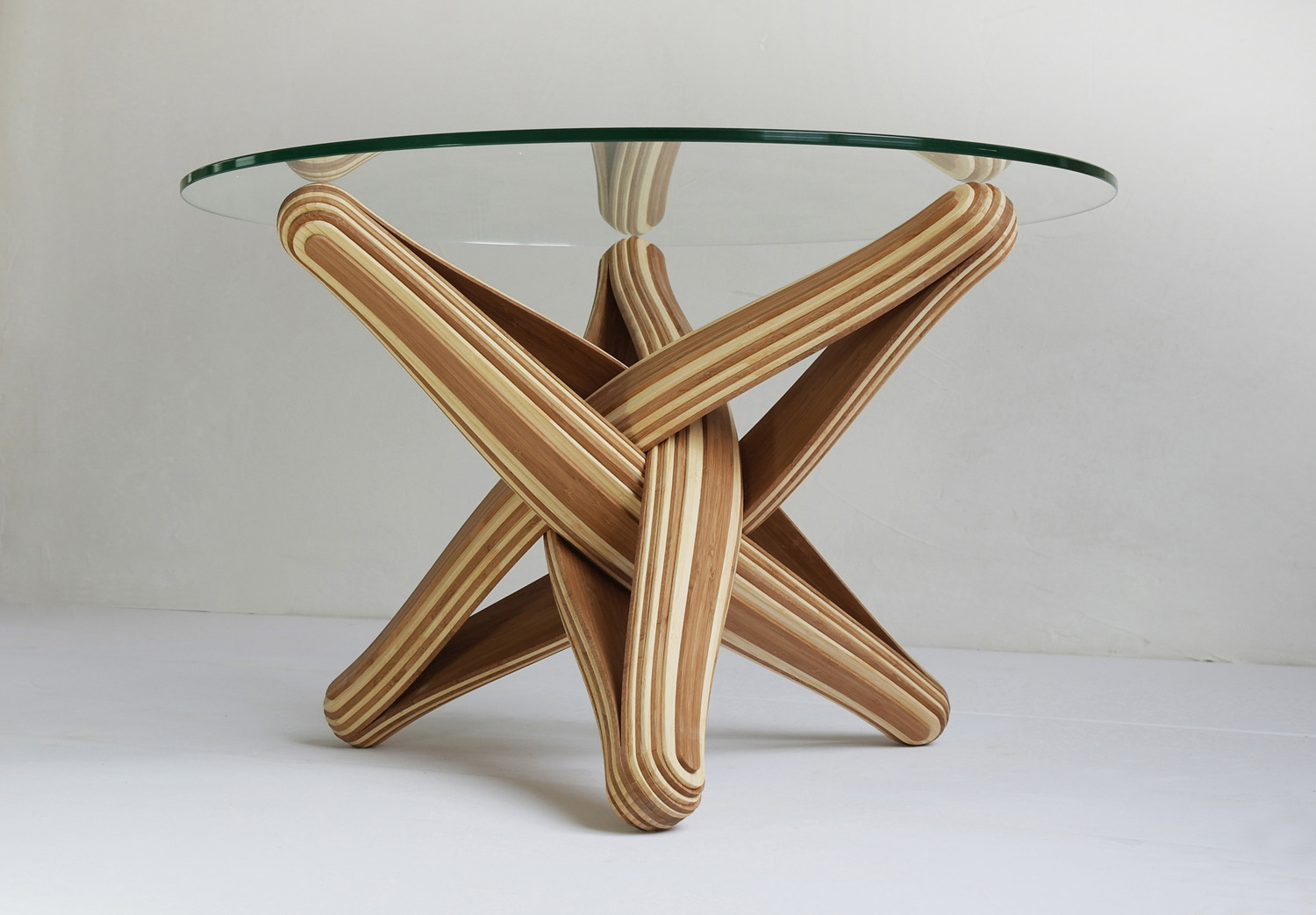 sustainable furniture lock is a bending, twisting coffee table made out of layered, TZCFDSX