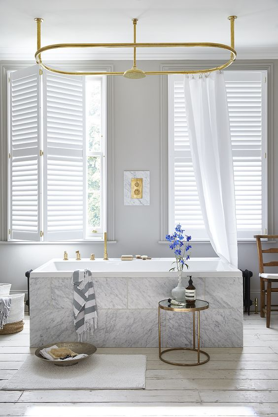 window treatment ideas these shutters are paired with lengths of fabric to soften the WSHBLFU