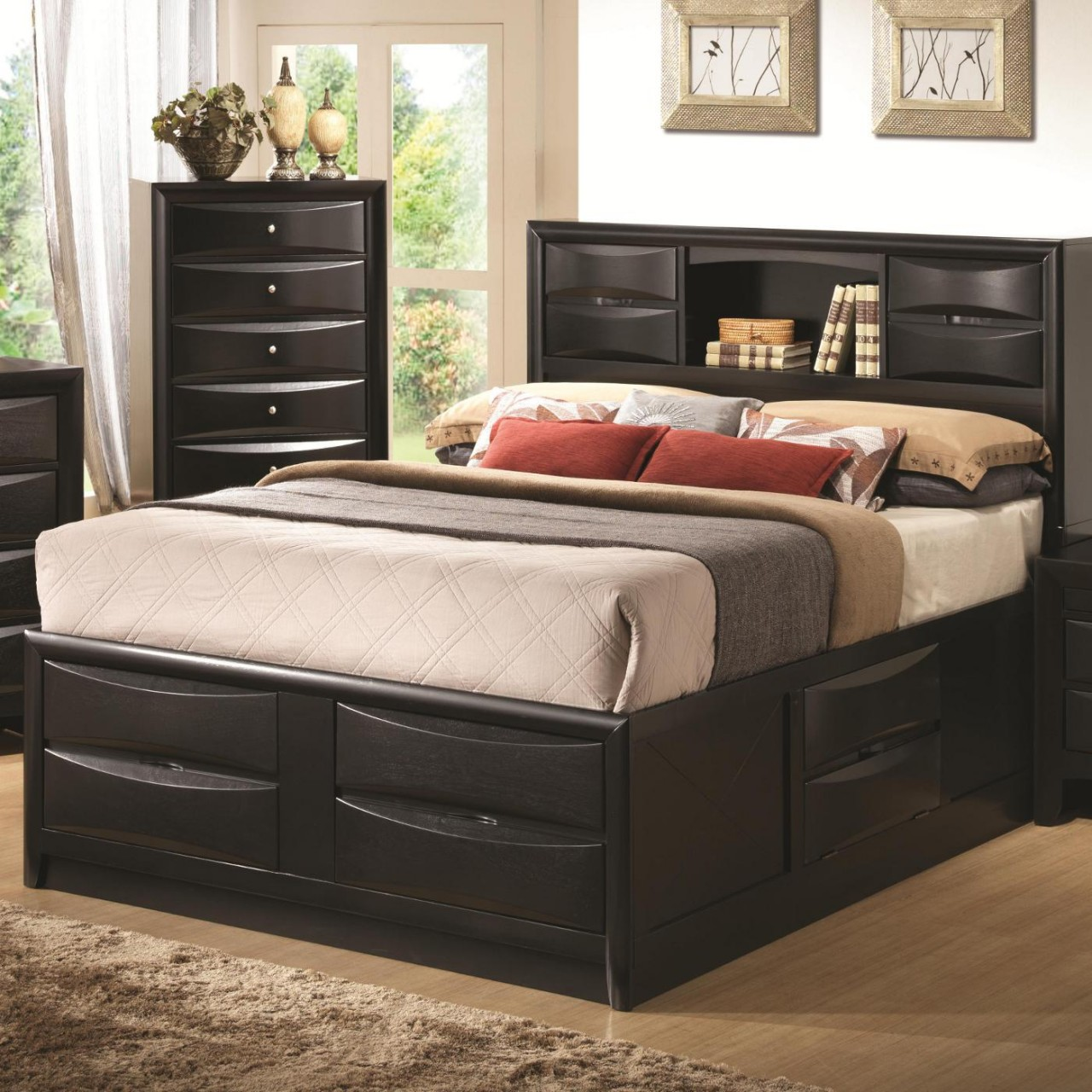 Black painted wooden bed frame with storage underneath and shelf plus a  pair of cabinets in