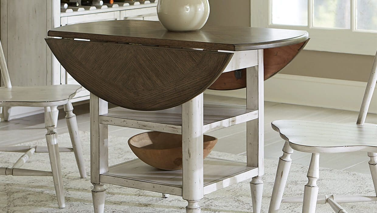 drop leaf table in a dining room with white chairs