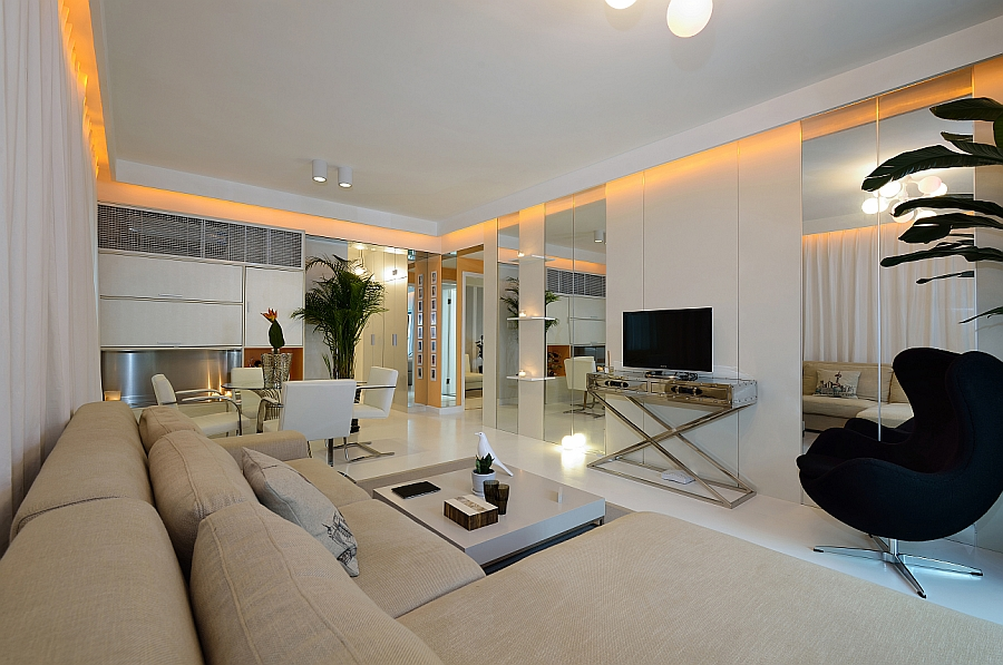 View in gallery Iconic decor and a neutral color palette in the living room  of the Shanghai apartment