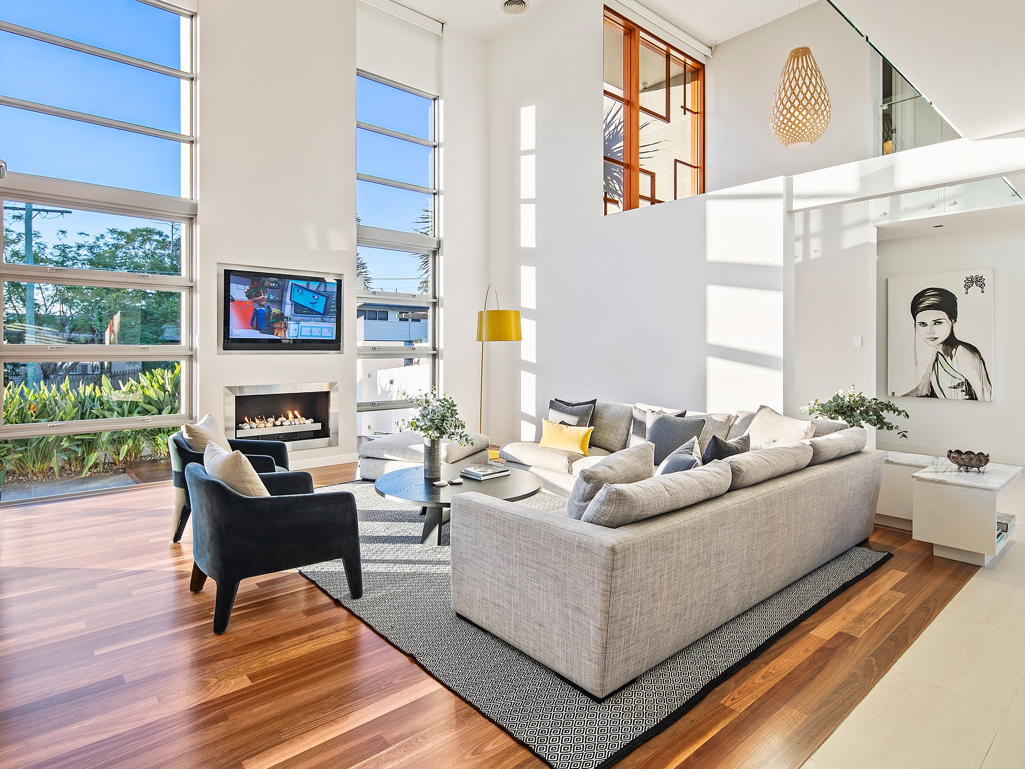 sun-filled living room with timber floors