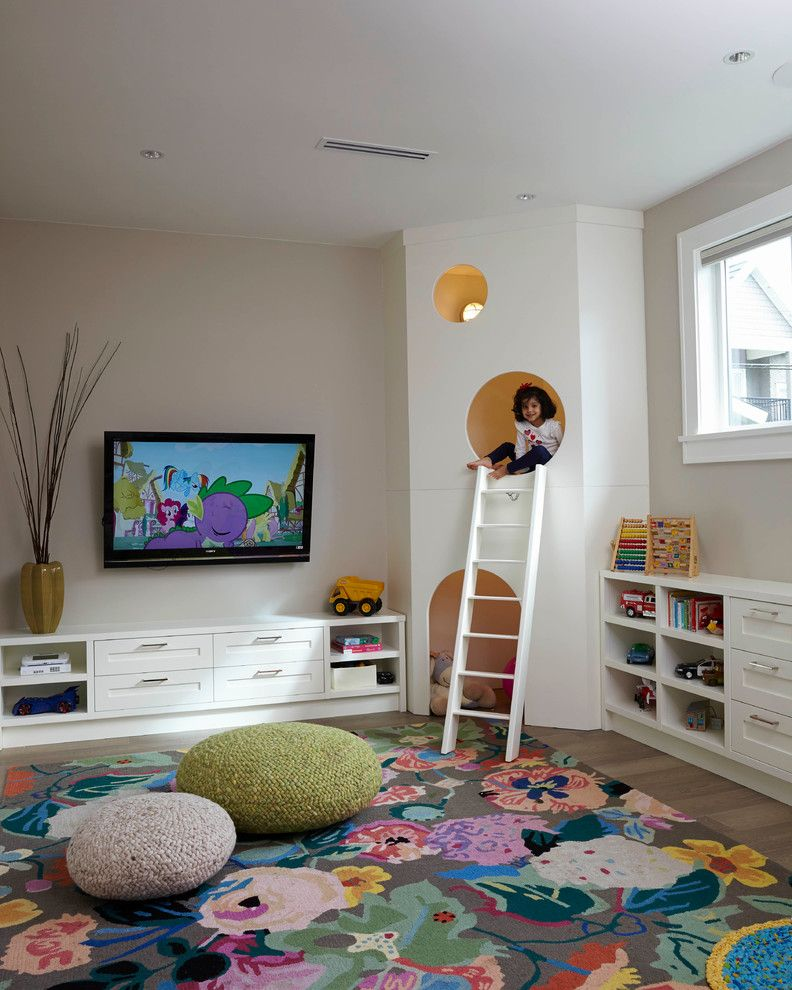 Kids playroom, large floral area rug, knit poufs, custom kids play house  with white ladder | MaK Interiors