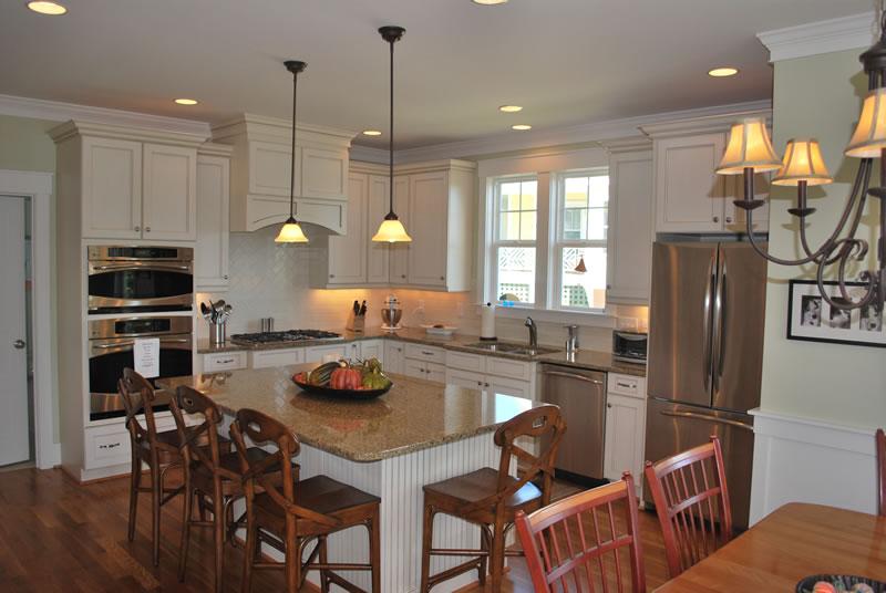 Retro White Kitchen Design Ideas with 4 Wooden Seating Kitchen Island Set,  Brown Granite Kitchen