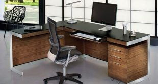 Keyboard tray and L-shaped desk = very nice. A little too modern/masculine  for me.