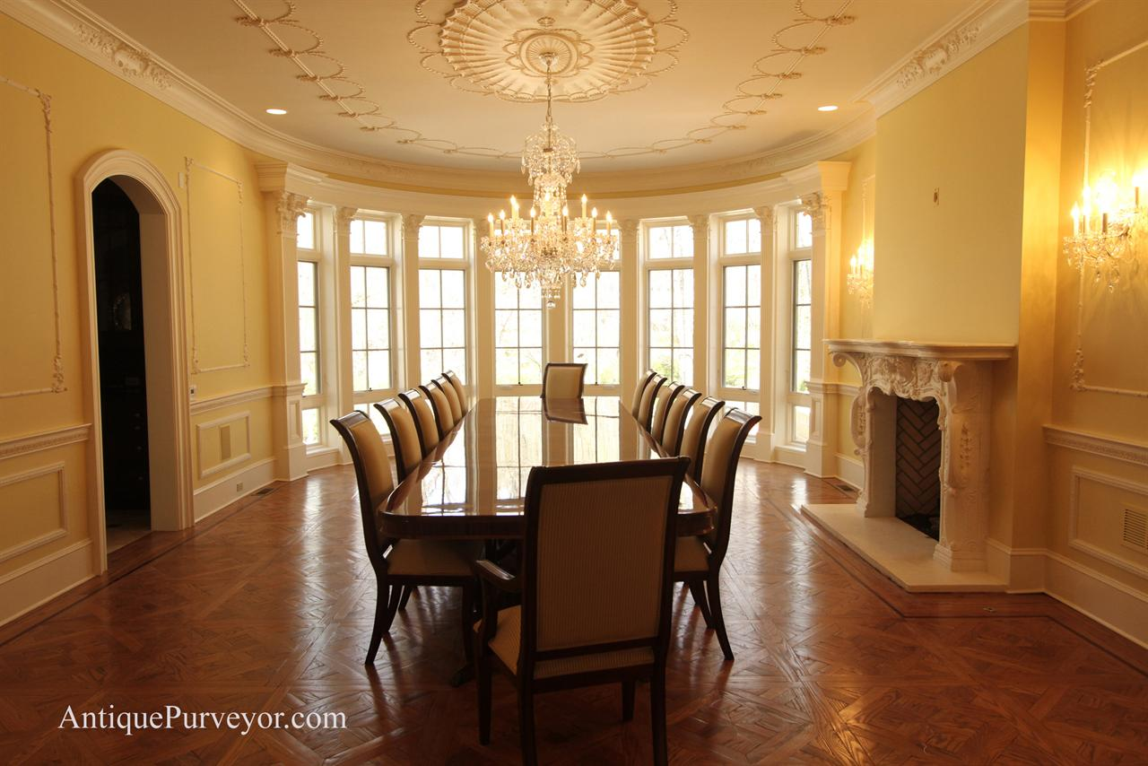 High end mahogany dining table in NJ estate shown with regency style chairs