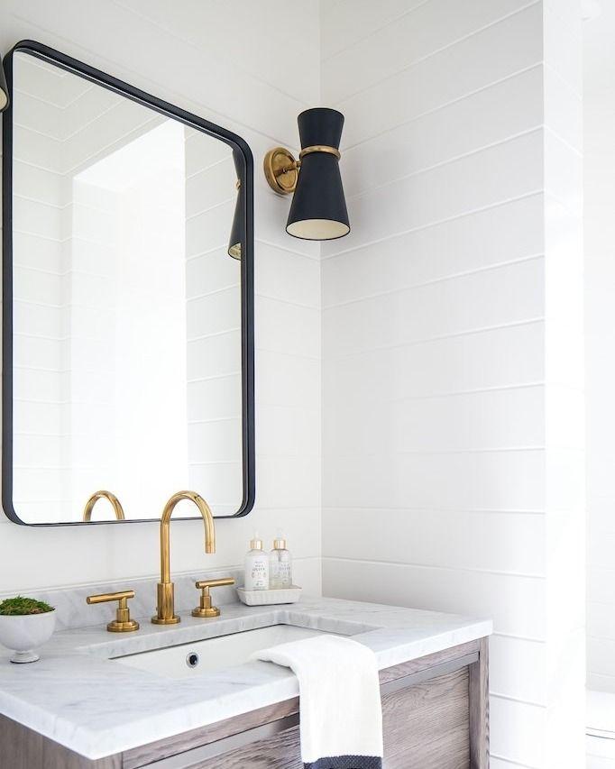 Metal framed mirror. Metal framed mirror. Mirror with metal border. White  bathroom. White and black bathroom. Large rectangle mirror. Rectangle mirror .