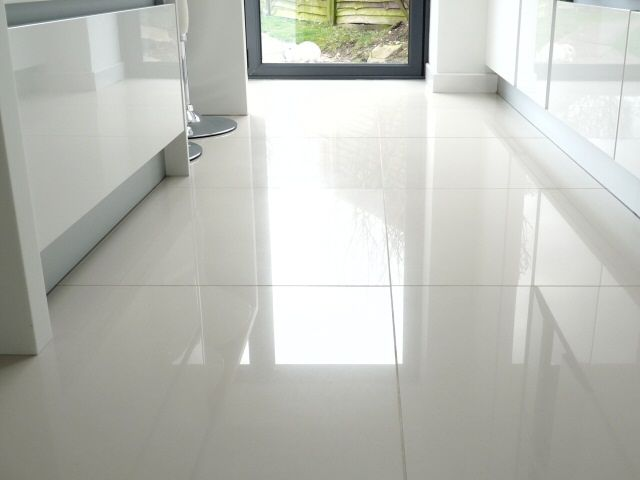 large white kitchen floor tiles. We put shiny white tiles in our bathroom  and they always look great - and are actually easy to keep clean.