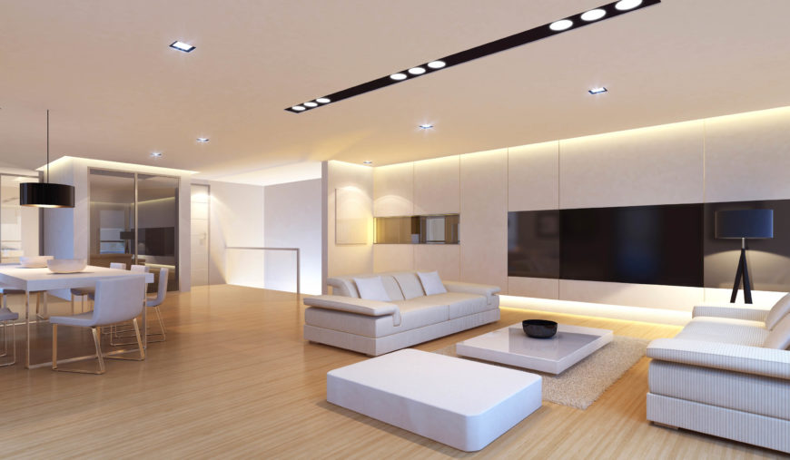 Here is a bright and simple modern living room that uses a number of simple  recessed